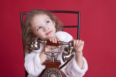 Dreamy little girl with old phone Royalty Free Stock Photo