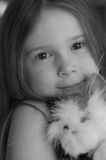 Girl and toy cat Royalty Free Stock Images