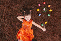 Dreamy little girls with abstract flower. easter aggs. top view. Royalty Free Stock Photos