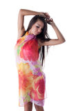 Dreamy long-haired model posing in colorful pareos Stock Photography
