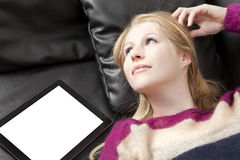 Dreamy-looking woman with tablet PC Stock Photography