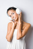 Dreamy looking young music listener. Stock Photos