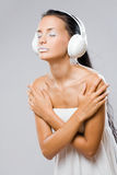 Dreamy looking young music listener. Stock Photography