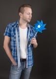 Dreamy man with pinwheel - man isolated on white backround Royalty Free Stock Photo