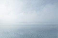Dreamy misty water scenery. Dreamy water scenery with morning mist over calm surface Stock Photos