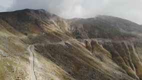 Dreamy mountains empty road overcast day stock video footage