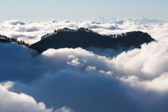Dreamy mountains. Views on Mountains in clouds on a climb to Mt. Rinjani in Indonesia Stock Images