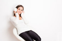 Dreamy music lover. Gorgeous dreamy young brunette woman wearing white headphones Stock Photo