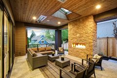 Dreamy outdoor covered patio with stone fireplace Stock Photos