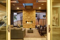 Dreamy outdoor covered patio with stone fireplace royalty free stock image