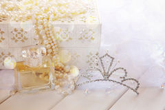 Dreamy photo of pearls necklace, tiara and perfume bottle Royalty Free Stock Images