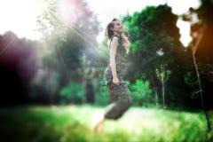 Dreamy photo of yong pretty woman jums Stock Photos