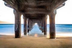 Dreamy Pier. A long exposure under a pier at Manhattan Beach Royalty Free Stock Photo