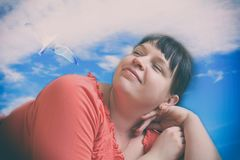 Dreamy plump girl Royalty Free Stock Image