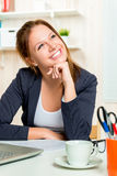 Dreamy portrait of a happy beautiful girl in the office Royalty Free Stock Photography