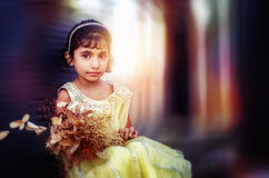 Dreamy portrait of small little girl holding flowers Stock Images
