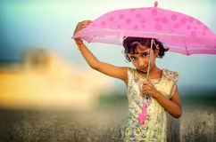 Dreamy portrait of small little girl holding umbrella Royalty Free Stock Photos