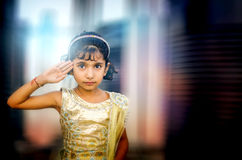 Dreamy portrait of small little girl saluting Royalty Free Stock Image