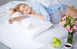 Dreamy pregnant woman Stock Image