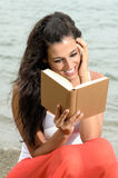 Dreamy reader in beach Royalty Free Stock Photos