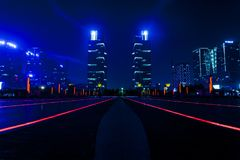 Dreamy night view of zhengzhou east station square and green space twin towers stock images