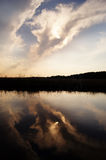 Dreamy reflection. Reflection of clouds in the water with dreamy figured contours Royalty Free Stock Photo