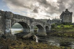 A dreamy Scottish castle with an old stone bridge Stock Images