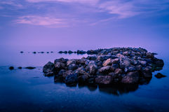 Dreamy Sea Rocks Scenery Stock Photo