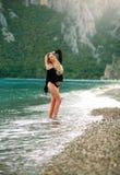 Dreamy sensual woman enjoys nature of sea beach Stock Photography