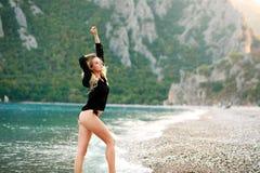 Dreamy sensual woman enjoys the nature of sea coast Stock Photo