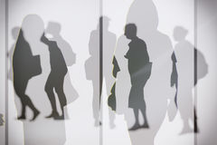 Dreamy silhouettes. Of people walking Stock Photos