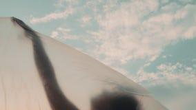 Female Dancer In Plastic Against Sunset Sky