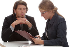 Dreamy staring employee. A dreamy employee staring at his pretty female boss Stock Photo