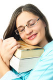 Dreamy student with books Royalty Free Stock Photo