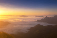 Dreamy sunrise on the top of the mountain with the view into mis Stock Images