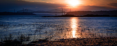 Dreamy Sunset Over the Bridges. Beautiful sunset over the St. Laurent river Royalty Free Stock Image