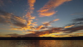 Dreamy after sunset over the lake. A very colorful sunset over the lake with cirrus clouds Royalty Free Stock Photos