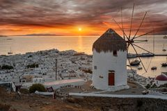 Dreamy sunset over Mykonos town, Cyclades, Greece. Dreamy sunset over Mykonos town and a traditional windmill, Cyclades, Greece royalty free stock photography