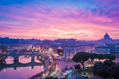 Dreamy sunset in Rome with St. Peter basilica. Dreamy sunset in Rome under a cloudy purple sky, view of St. Peter basilica stock photo