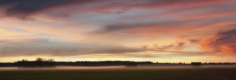 Dreamy sunset scenery with fog over the fields Royalty Free Stock Photos