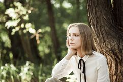 Dreamy teen girl in white blouse with black ribbon Stock Photos