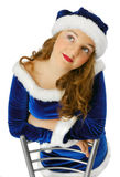 Dreamy teenage girl in suit of Santa Claus Royalty Free Stock Photos