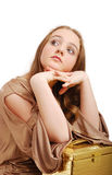 Dreamy teenage girl with a trunk. Royalty Free Stock Images