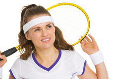 Dreamy tennis player with racket Royalty Free Stock Images