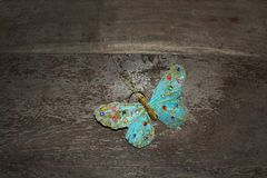Dreamy turquoise beautiful butterfly on brown rustic