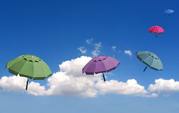 Dreamy umbrellas. Umbrellas floating in the sky royalty free stock image