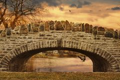 Upper Onondaga Park in Syracuse Upstate New York, USA. Dreamy View of The Lake Water and The Stone Bridge and The Birds around Royalty Free Stock Photos