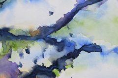 Abstract watercolor backround on paper. Dreamy watercolor abstract backround on watercolor paper with blues black and green royalty free stock photos