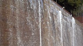 Waterfall and Brick Wall. Dreamy Waterfall and Brick Wall in a Park stock video footage