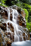 Dreamy waterfall in the forest Stock Photo